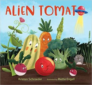 The cover of ALIEN TOMATO, Kristen Schroeder's debut picture book. It features a bunch of anthropomorphic vegetables, along with Allie, a mysterious red orb who's been dropped in their midst.